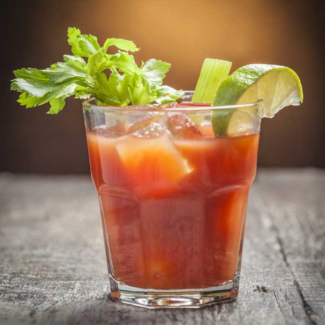 A classic Bloody Mary garnished with lemon, lime and a celery stalk.
