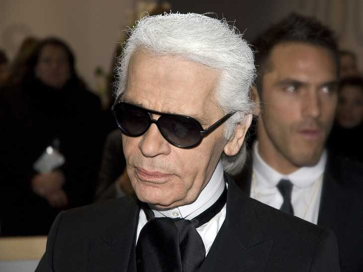 Karl Lagerfeld with his body guard, who also has modelled for KL.
